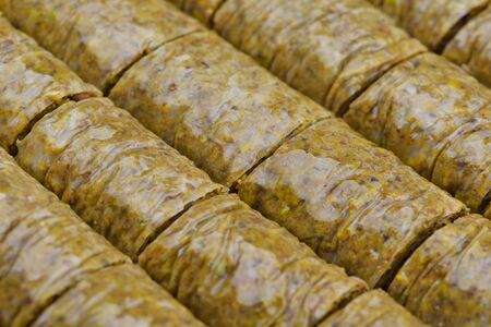 is well known: traditional dessert turkish baklava,well known in middle east and delicious isolated on white background