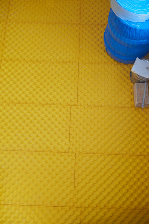 under ground: yellow underfloor heating posed in a under construction building