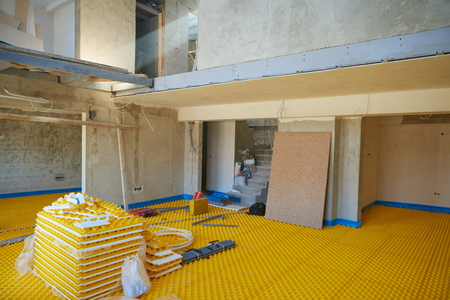 yellow underfloor heating posed in a under construction building photo