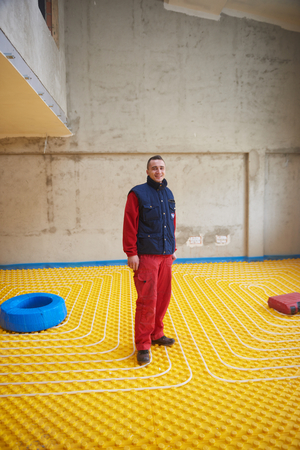 conduction: Group of worker installing underfloor heating and colling in modern home Stock Photo