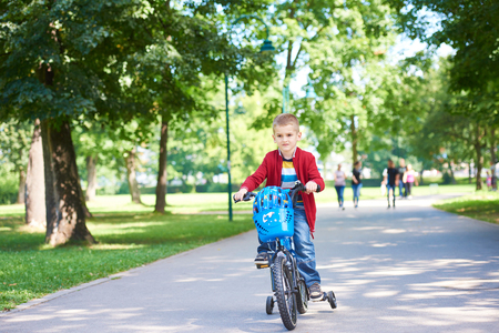 bycicle: Young boy on the bicycle at Park Stock Photo