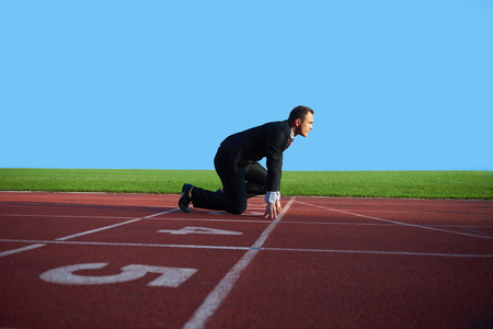 business man in start position ready to run and sprint on athletics racing track Stok Fotoğraf