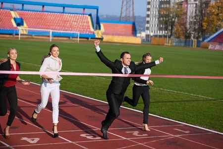 start position: business people running together on racing track
