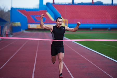 athletic runner finishing line track