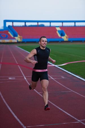 finishing line: athletic runner finishing line track