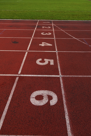 numbering: Red athletic track treadmill at the stadium with the numbering. Stock Photo