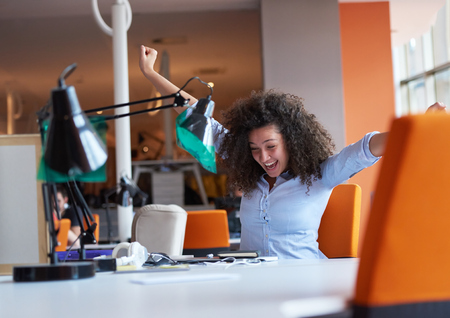 happy young curly  business woman in the modern office Stock Photo