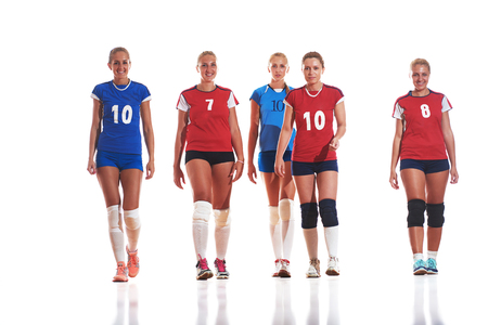 volleyball serve: volleyball game sport with group of young beautiful  girls indoor in sport arena ball net Stock Photo