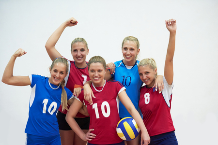 indoor: volleyball game sport with group of young beautiful  girls indoor in sport arena ball net Stock Photo