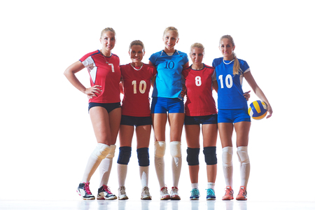 volleyball game sport with group of young beautiful  girls indoor in sport arena ball net photo