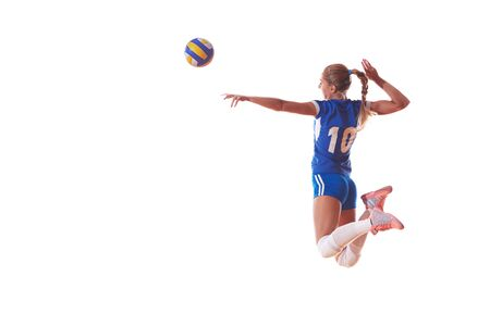 kick ball: volleyball woman jump and kick ball isolated on white background