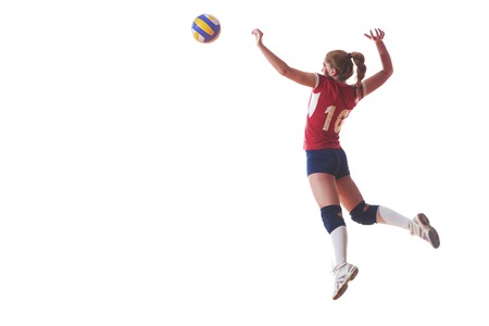 volleyball woman jump and kick ball isolated on white background photo