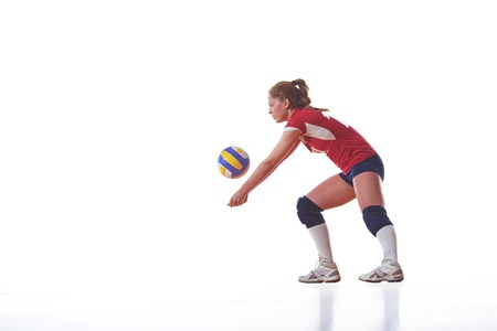 volleyball team: volleyball woman jump and kick ball isolated on white background