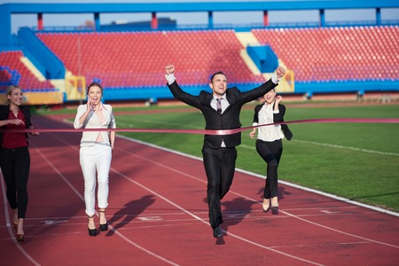 men in suit: business people running together on racing track