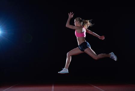 Athletic femme onrace piste de course Banque d'images - 42392120