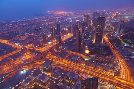 Dubai night skyline. Dubai streets by night. Stock Photo