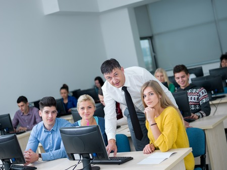 get help: group of students with teacher in computer lab classrom learrning lessons,  get help and support