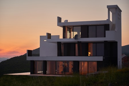 houses on water: External view of a contemporary house modern villa at  sunset