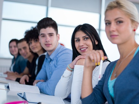 library student: happy students group  study in classroom