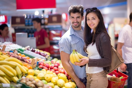 fruit market: Young couple shopping in a supermarket