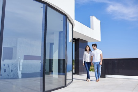 modern home: happy young romantic couple have fun relax smile at modern home outdoor terace balcony terace