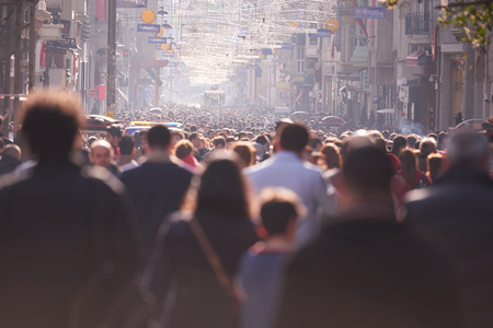 people crowd walking on busy street on daytime. Stock Photo