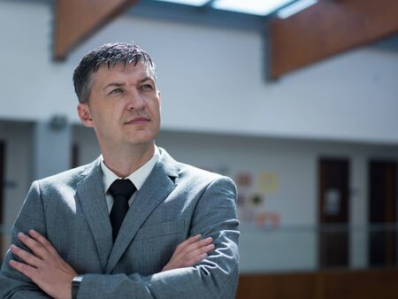 bussines: portrait of middle aged business man at modern office space indoors