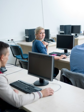 computer room: technology students group in computer lab classroom