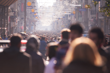 overcrowded: people crowd walking on busy street on daytime