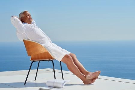 handsome old man: Portrait of senior man sitting outside