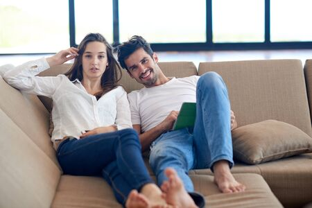 couple home: romantic relaxed young couple at modern home using tablet computer