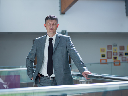 bussines people: portrait of middle aged business man at modern office space indoors