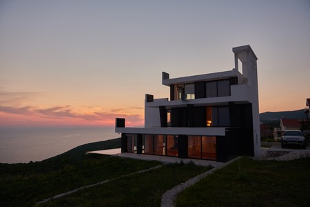 contemporary house: External view of a contemporary house modern villa at  sunset