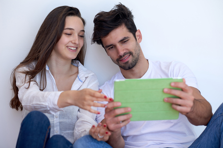 modern home: romantic relaxed young couple at modern home using tablet computer