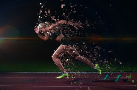 athlete: pixelated design of woman  sprinter leaving starting blocks on the athletic  track. Side view. exploding start Stock Photo