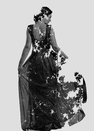 multiple exposure: double exposure of woman in fashion dress with nature tree branches background