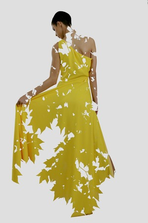 double exposure of woman in fashion dress with nature tree branches background photo