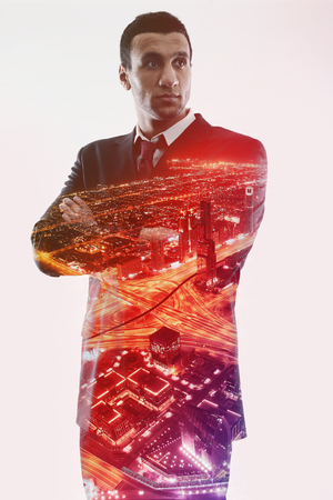Double exposure concept of businessman and city photo