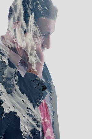 double exposure of young business man with  mobile phone and mountain in winter photo