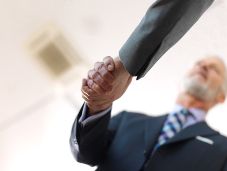 two men: business partners, partnership concept with two businessman handshake Stock Photo