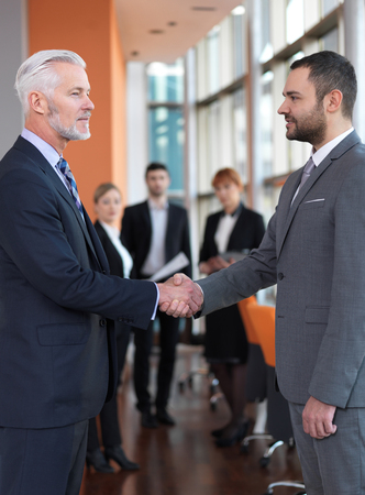 business partners: business partners, partnership concept with two businessman handshake Stock Photo