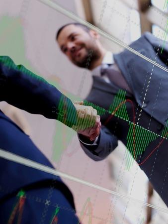 partnership: Double exposure design. Business partners, partnership concept with two businessman handshake