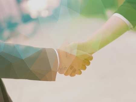 businessmen handshake: Double exposure design. Business partners concept with businessman and businesswoman handshake at modern office indoors Stock Photo