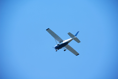 cessna: small retro airplane, clear blue sky in background Stock Photo