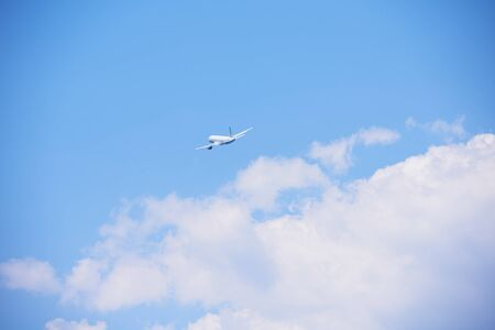 corporate airplane: modern airplane travel,  clear blue sky in background