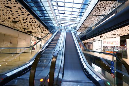 malls: Shopping mall center escalators. Zoom blur movement. Stock Photo