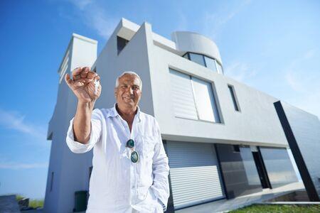 one man: senior man in front of luxury modern home villa Stock Photo