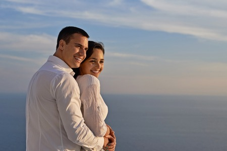 couple outdoor: happy young romantic couple have fun relax smile at modern home outdoor terace balcony
