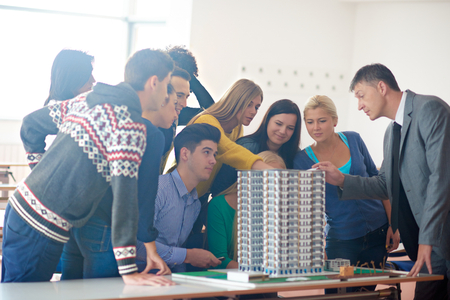 teaching: group of students with teacher on class learning lessons Stock Photo