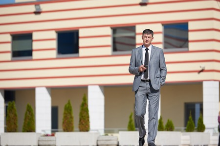 mature businessman: urban outdoor portrait of middle aged senior  business man Stock Photo